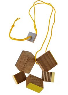 Blocks necklace by Katy Hackney, 2012. Oak, box, and pear woods, plywood, colorcore, formica, nylon, 18ct gold.
