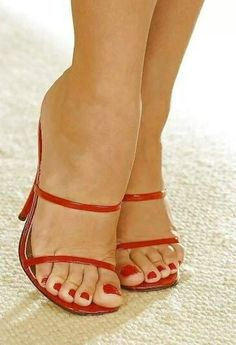 Red strappy mules and great feet