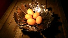 Feather bowl with chook eggs. https://www.facebook.com/rekindledmetal/