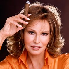 Raquel Welch, Classic Diva with a fine cigar.