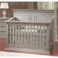 The Baby Cache Vienna 4-in-1 Lifetime Convertible Crib in the Ash Gray style features a highly functional design that allows the crib to be transformed to a toddler bed, a daybed and a full-size bed to accommodate your growing child (bed rails and toddler rail sold separately). The sturdy poplar wood construction is designed to endure, and the ash gray finish and full-panel headboard are stylish and elegant. This crib meets all safety guidelines and is JPMA certified.