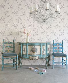 Rachel Ashwell's Shabby Chic blue painted floral furniture with wallpaper in the background