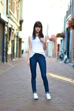Ankle jeans with white flowy tank and converse