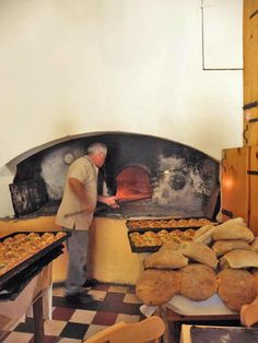 Tal - Furnar Restaurant in Xaghra with the only remaining stone oven on the Maltese islands!  Here we can see the fire burning in the huge oven where bread, pizzas, fitera etc are cooked fresh every day! // Malta Direct will help you plan an unforgettable trip