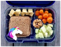 """It's our first day of school! And my kids were so excited they asked if they could help me pack their lunches (I said yes, of course). My 7-year-old went straight for our new Yumbox and put in a homemade PB & honey """"uncrustable"""" (from the freezer - I added the Unicorn toothpick), honey dew melon, roasted cashews, sungold cherry tomatoes (from our garden!), and cheddar cubes."""
