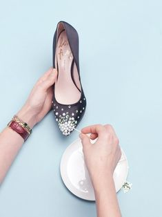 """Then, take the smaller rhinestones in the same color, and place them in between the larger rhinestones, and going back farther towards the back of the heel than the larger stones, or the pearls. Place one or two on the sides of the shoes for extra """"fade"""" effect. You can also stick some tiny stones in blank spots between the pearls."""
