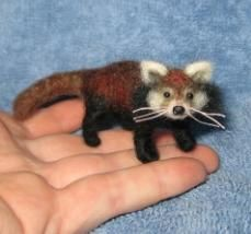 felted red panda--In case you didn't notice I am DYING to have a tiny adorable felted creature.... :)