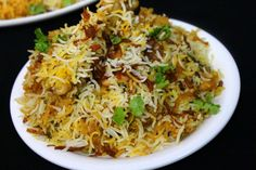 chicken biryani recipe, how to make biryani – Yummy Indian Kitchen Chicken biryani recipe is shared along with step by step details and a video procedure. This is a special eid recipe made for all those celebrating eid… Indian Food Recipes, Asian Recipes, Eid Recipes, Recipies, Ramadan Special Recipes, Ramadan Recipes, Iftar, Biryani Chicken, Chicken Biryani Recipe Indian