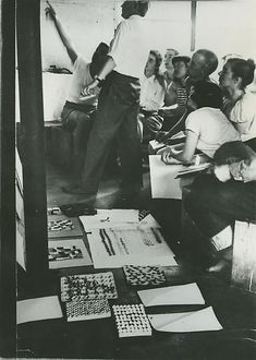 Ray Johnson, Ruth Asawa and other students in Josef Albers' class at Black Mountain College, ca. 1945-46. Photo by Josef Breitenbach.