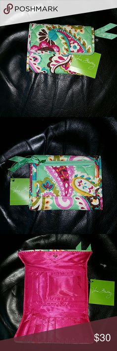 """Nwt! RARE Vera Bradley """"Tutti Frutti"""" Euro Wallet Nwt! Vera Bradley """"Tutti Frutti"""" Euro Wallet  -gorgeous Floral pattern  -flap closure -1 large compartment inside with 6 card slots, 2 smaller side compartments, an ID slot -1 zippered compartment on back of wallet Vera Bradley Bags"""