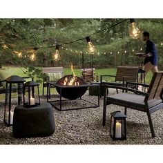 Shop Carswell Large Fire Pit. Architectural firepit adds a modern edge to the traditional iron firepit, suspending a round bowl from an open, square frame, all with a smart black, heat-resistant finish.