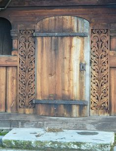Details of entrance to Heddal stave church, which is a triple nave stave church and is Norway's largest stave church. It was constructed at the beginning of the 13th century.