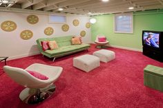 exposed ceiling pink rug floral accent green wall green sofa white chair pink pillow TV of Boosting Your Mood in Splendid Basement Family Room