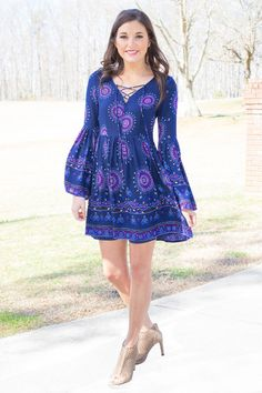 There is nothing like a stroll in the park with your love on a Sunday afternoon. Just like the love you have for each other, this dress is both comfortable and easy. You won't believe how gorgeous this navy boho dress is in real life! Dress features a lace up V-neckline, gathered waist, long billow sleeves and pretty pattern. Fully Lined. It is made of 100% Rayon. Karigan is wearing a size small.