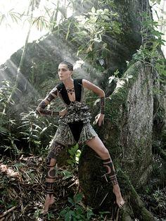Daria Werbowy in a Givenchy by Riccardo Tisci optical-print ruffled chiffon dress.