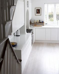 White Kitchen with Solid Surface White Corian Countertops