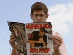 Louis Theroux reading a hip-hop magazine