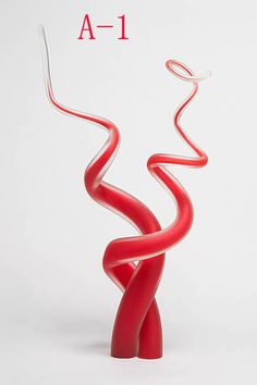 Blown Glass Cake Topper. Noah works with glass blowers so it would be pretty readily available.