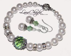 Mother of The Bride Gift Bracelet and Earrings Set Swarovski White Pearl Sterling Silver Green Crystal Wedding. $31.00, via Etsy.