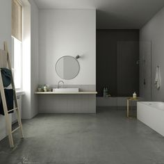Master bathroom view. Private apartment in Florence, Italy by Linee Studio. Concrete floor and minimalist geometries. Washbasin by Kartell-Laufen, taps by Zucchetti-Kos, tiles by Made a Mano.