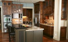 The cabinets are too dark but an interesting island.  From Northwood Cabinets
