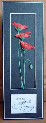 """By Lesley. Used Memory Box """"Prim Poppies"""" die. Cut two sets of red & one of green. Cut individual petals out of the red, burnished them into curves & layered them on top of each other with some black Liquid Pearl stamens in between. Framing for the card is separate piece of cardstock layered on top of the base card. It affords a little protection for the poppies."""