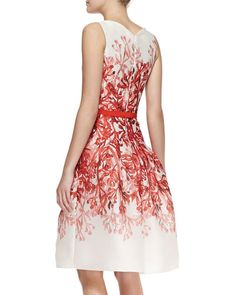 Full-skirted Carolina Herrera dress is pretty and fresh in printed silk with pockets.      Carolina Herrera sleeveless printed dress.     V-neckline and notched back.     Bias seaming at fitted bodice.     Solid band at natural waist.     Full fluted A-line skirt.     Skirt pockets.     Hidden back zip.     Silk.     Made in the USA of Italian material.