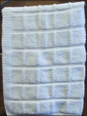 Baby's First Blanket from AnniesCatalog.com -- This easy knitting pattern fits most bassinets and car seats.