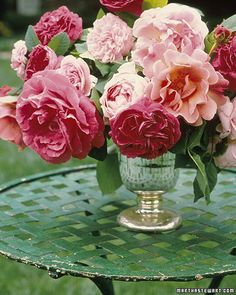 Garden Rose Arrangement 'Charles de Mills,' 'The Reeve,' and 'Pearlie Mae' roses from Martha's garden were cut close to the bloom and the stems woven together for support in a mercury-glass cup.