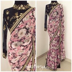 Because strong prints are for strong girls. Stunning lavender color designer saree with floral print. Black color designer blouse with floret lata design hand embroidery work. Blouse with full sleeves. Office Fashion Women, Black Women Fashion, Indian Fashion, Womens Fashion, Floral Print Sarees, Saree Floral, Indie Mode, Bollywood Designer Sarees, Trendy Sarees