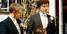 Sherlock awkwardly patting human child.
