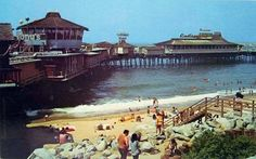 Redondo Beach Pier...That's my Dad (striped tank-top), Mom and me climbing on the rock! Must have been '74-77...we were there every weekend!