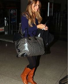 brown boots, black purse, and black bags