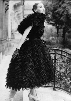 1959 Denise Sarrault in a black cocktail dress of Valenciennes tulle, Givenchy