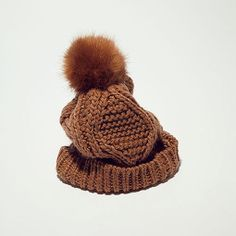 get a chunky knit  bobble hat to avoid windswept hair this winter #practical&stylish