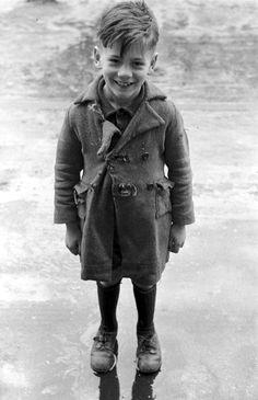 The boy with torn coat,Paris, 1951, a photo byEd van der Elsken
