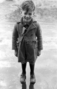 The boy with torn coat, Paris, 1951, a photo by Ed van der Elsken via mimbeau