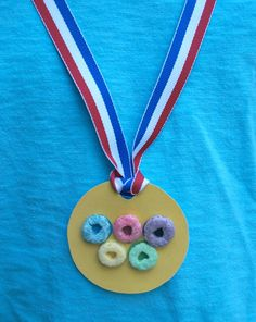 Olympic Games Crafts for Kids -- Olympic Medal with Fruit Loops --> SO clever!