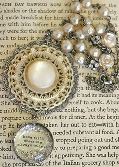 bethquinndesigns, mother of pearl centerpiece over filigree base, with a custom made resin dangle featuring silver glitter and an embedded quotation,  hanging from a chain with lovely glass pearls and rhinestone beads. Love this.
