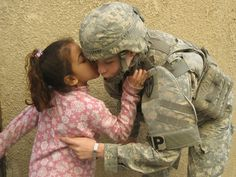 Real Friends in Baghdad, Iraq. Military Police with Iraqi girl.