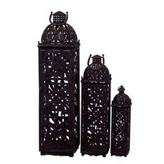 "Three openwork metal lanterns.   Product: Small, medium and large lanternConstruction Material: MetalColor: RusticDimensions: 16.5"" H x 4.5"" W x 4.5"" D (large)"