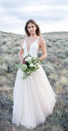 Style 9500 by Allure Bridals. This soft tulle ball gown features a bodice with dramatic plunge. Romantic and sexy! @allurebridals #AllureBridals #wedding #bridal #ad #weddingdress #weddinggown #winterbride #weddinginspiration #romantic #weddingdressideas