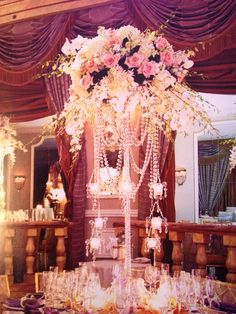 Love the centerpiece, just has it all bling, beautiful flowers and candle light