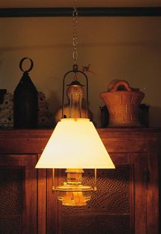 LEHMAN'S. Aladdin Classic Tilt-Frame Oil Lamp with Opal Shade.  This site offers new treadle sewing machines for living off the grid, as well as country store candy.