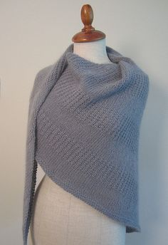 This is a triangle (slightly asymmetrical) shawl , knit sideways.