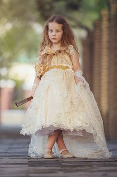 """Captivating Amour"" is the perfect flower girl dress! This one of a kind hand-made gown is made of a Beautiful Shantung fabric. The neckline features a gorgeous crystal/pearl trim. The waist band feat"
