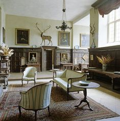 The Hall at Chastleton House. The beast above the dais has real antlers and a wooden head, combined with a painted body in only two dimensions.