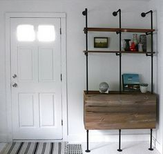 Industrial pipe bookshelf with closed storage (bar cabinet?)