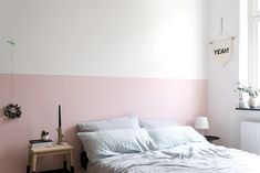 Half painted pink wall in the bedroom - www.craftifair.com