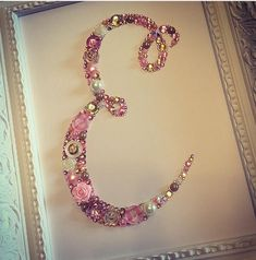Beautiful handmade gift for all occasions. These make perfect personalised gifts for birthdays, christenings, new baby, baby shower etc. A lovely addition to any room. These initial / letter / name frames are created using high quality buttons, embellishments & genuine Swarovski